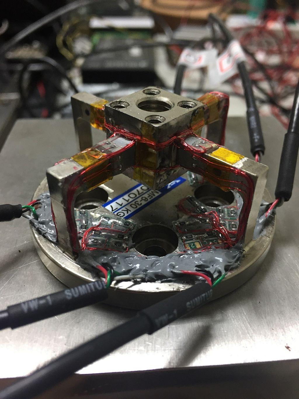 Six-axis force/torque sensor and calibration technique
